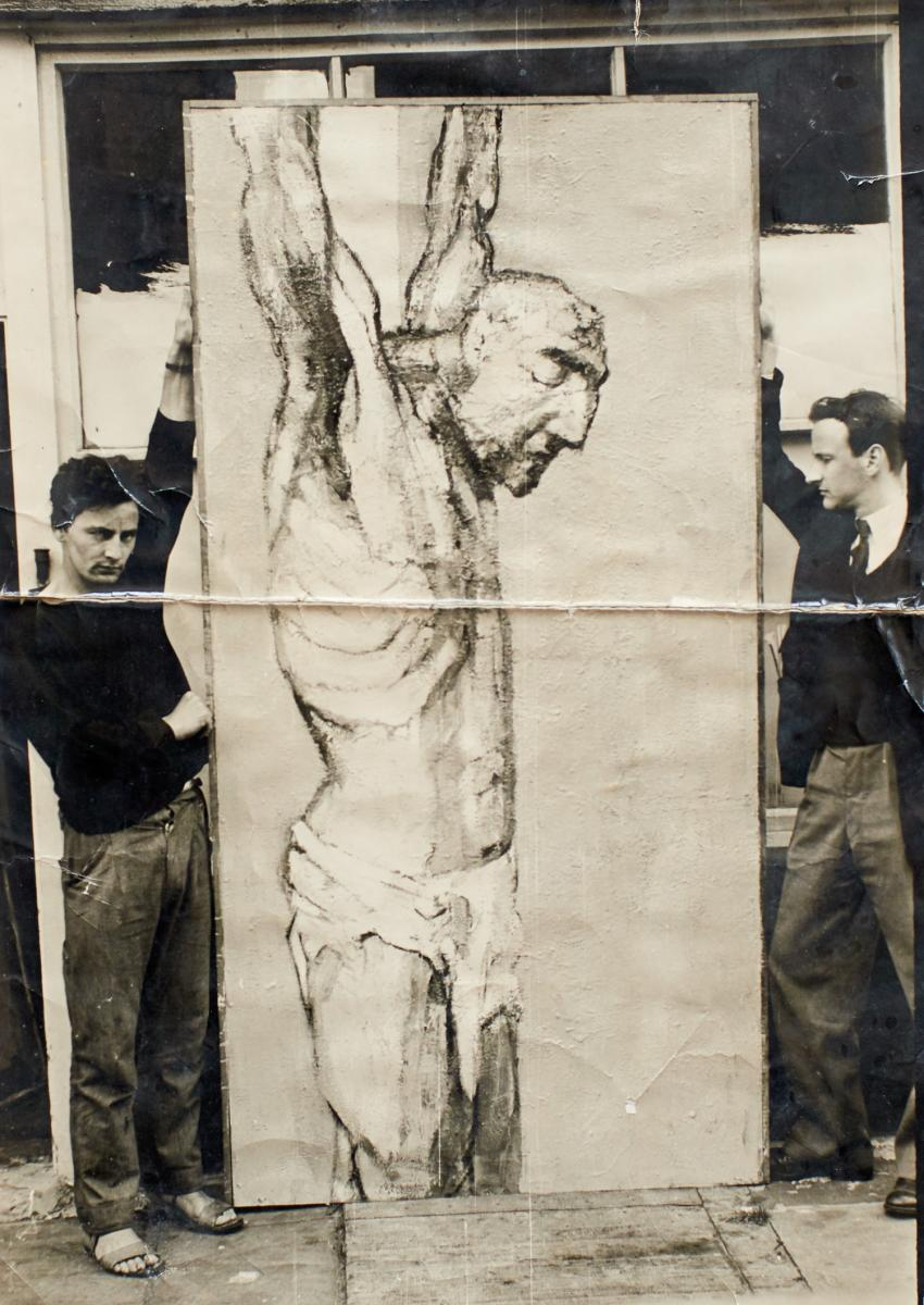 Anthony Whishaw (left) with his painting The Crucifixion 1956, 244 x 122 cm, oil on board during his time at the Royal College of Art.