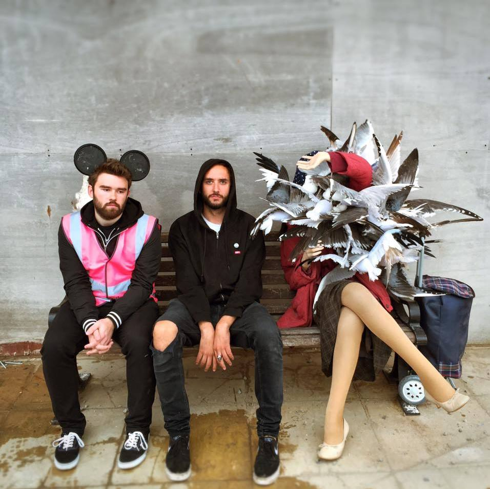 Doug Gillen (middle) at Dismaland - the woman with pigeons is an artwork