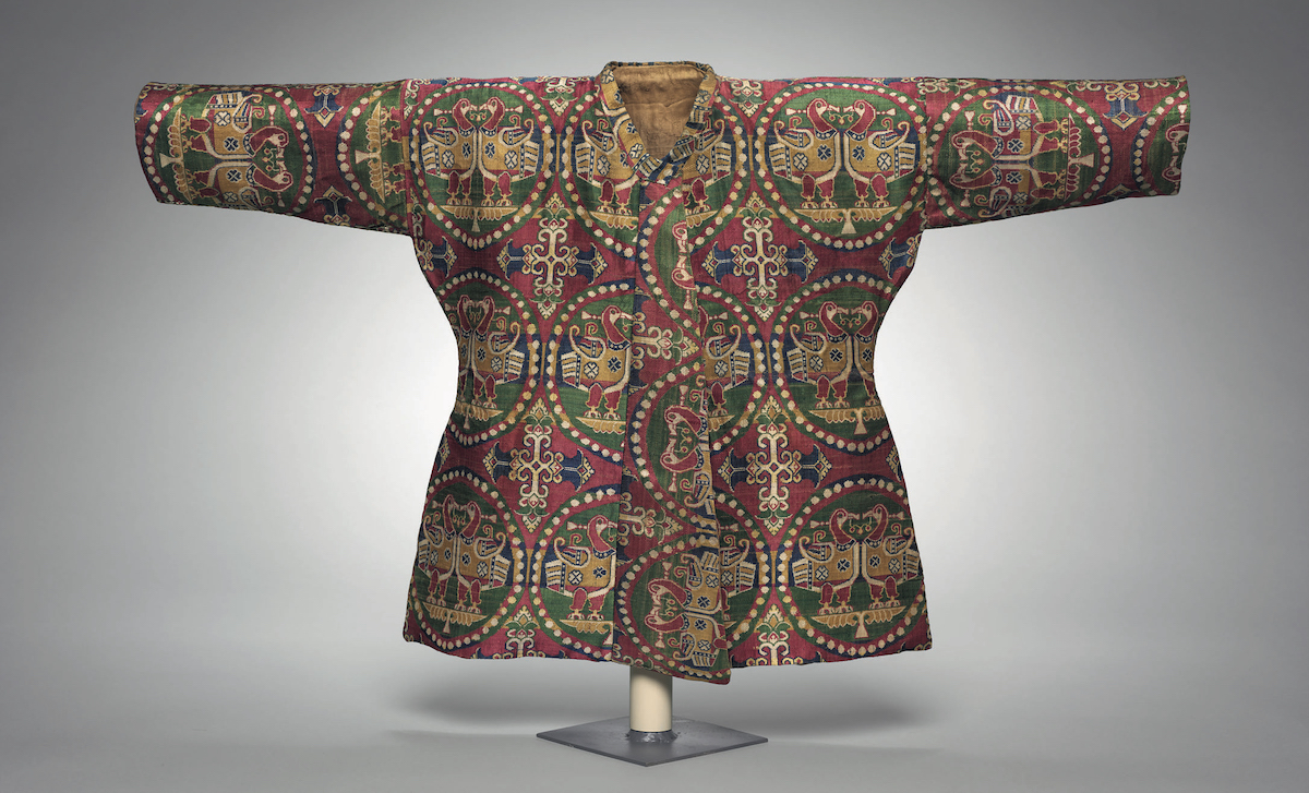 A Child's silk coat. The two materials of the outer part and lining used in this child's coat, which was found with a pair of trousers, reflect the exchange and blending of silk cultures along the Silk Road. Image credit: Cleveland Museum of Art
