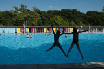 Children jumping for joy at Lido