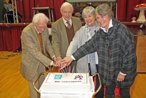 Founder members cutting the 20th Anniversary cake in December 2017