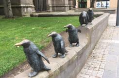 Penguins outside church